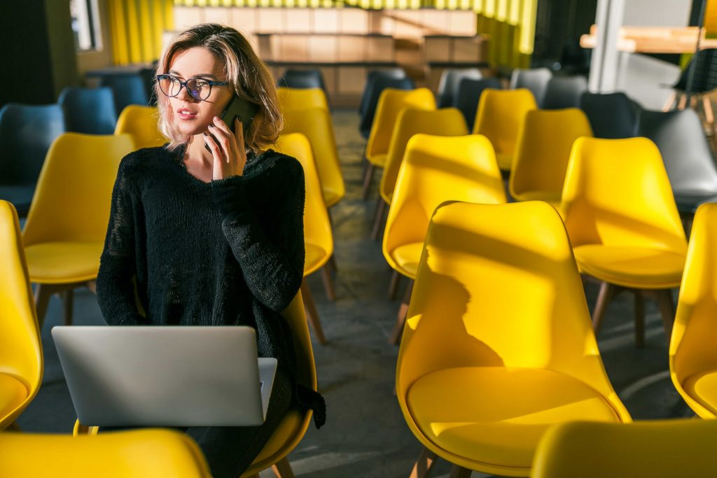 young-pretty-woman-sitting-alone-working-on-local-seo-keyword-research
